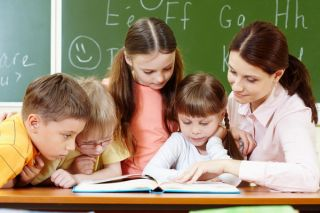 A fost promulgată legea prin care învăţământul obligatoriu este extins la 15 clase
