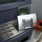 Bărbat prins în timp ce încerca să fure bani din bancomat