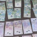 Arădenii, indignaţi după ce Primăria a postat o imagine cu bani confiscaţi de la un cerşetor